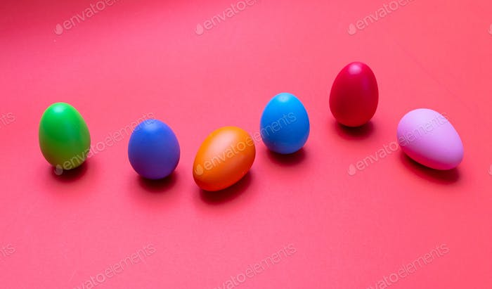 Easter eggs, pastel colors painted, orange color background