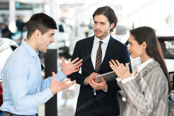 Car Seller Looking At Couple Having Quarrel