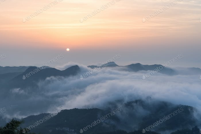 the sunrise and the sea of clouds at the top of the mountain
