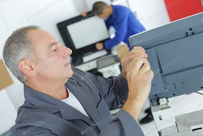 Technician woking on appliance
