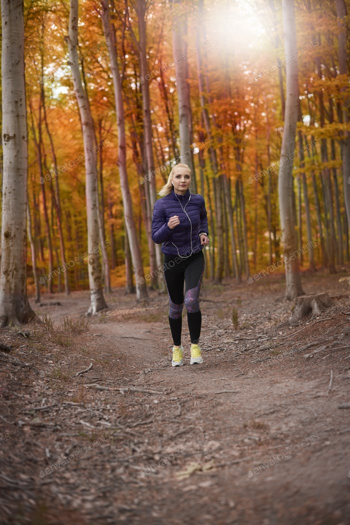 Woman loves jogging in the autumn