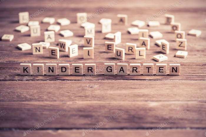 wooden elements with letter collected to word kinder garten
