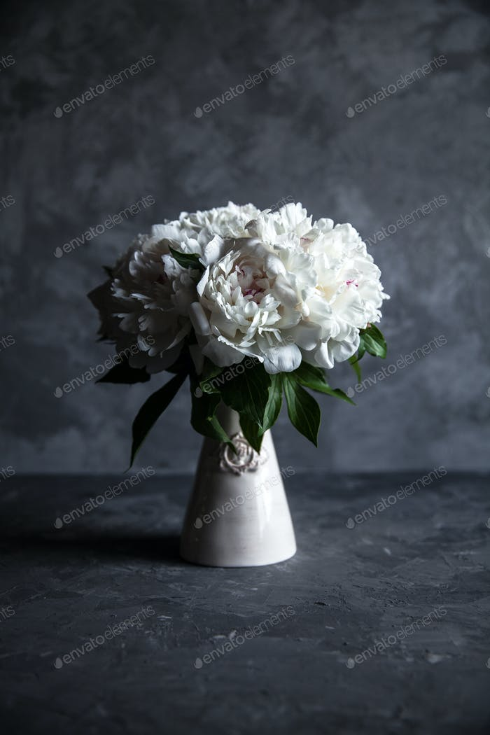 Beautiful peonies on grey concrete background. Wedding, birthday, valentine's day, gift