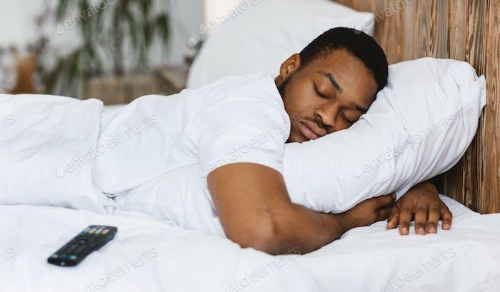 Fast Asleep Black Man Sleeping Embracing Pillow Resting At Home