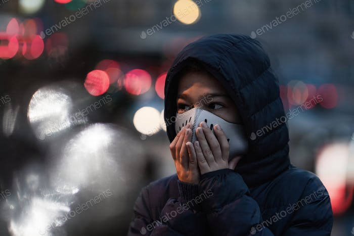 Polluted Air in the City. Wearing protective Mask