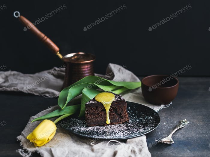 Perfect morning set for woman. Piece of truffle chocolate cake with lemon curd icing, hot coffee
