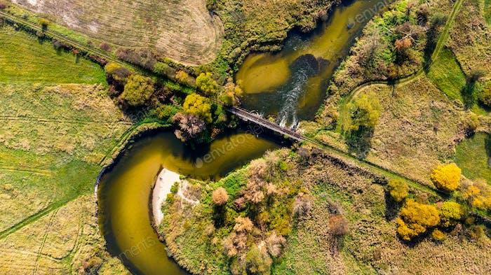 Old Bridge Over Nida River Bend in Swietokrzyskie,Poland. Aerial