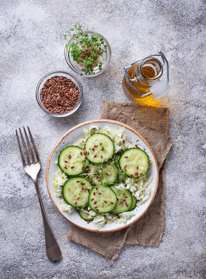 Healthy spring salad with cucumber, flax seed and cress