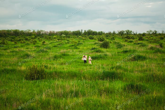The healthy rural life. The woman and man in the green field