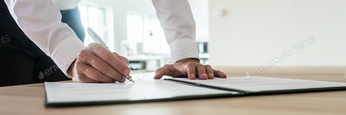 Businessman signing important document