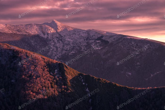 overcast sunset dye purple the snowy mountains
