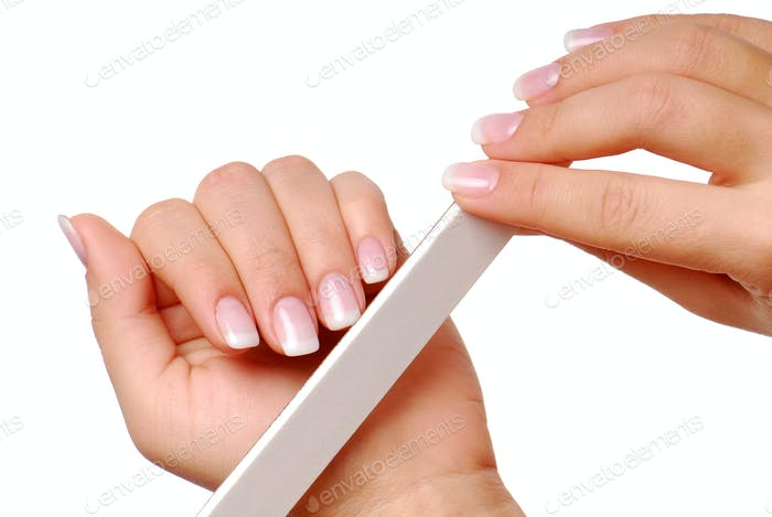 Woman polishing  her fingernails.