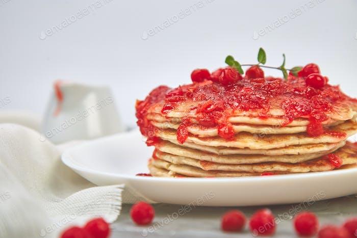 American pancake with jam - berry, viburnum, cranberry