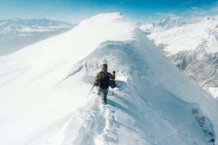 sportsman go with snowboard equipment