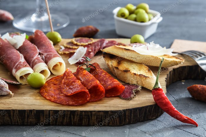 Typical spanish tapas concept. include variety slices jamon, chorizo, salami