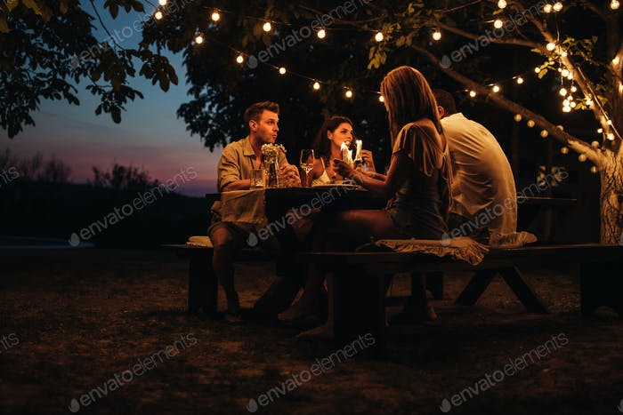 Romantic dinner in a backyard