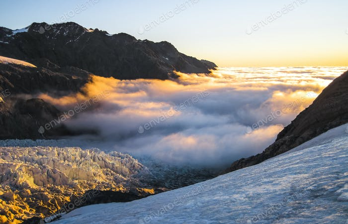 Clouds Over The Fox Glacier at Sunset in New Zealand