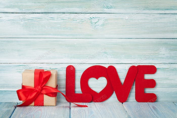 Valentines day greeting card with love word and gift