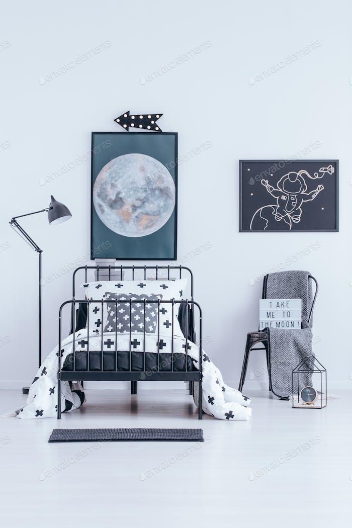 Astronaut poster in bedroom interior