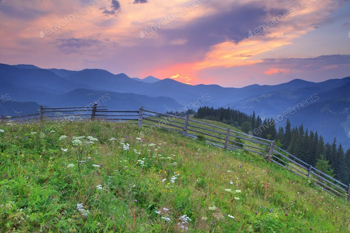Beautiful sunset in the mountains in summer