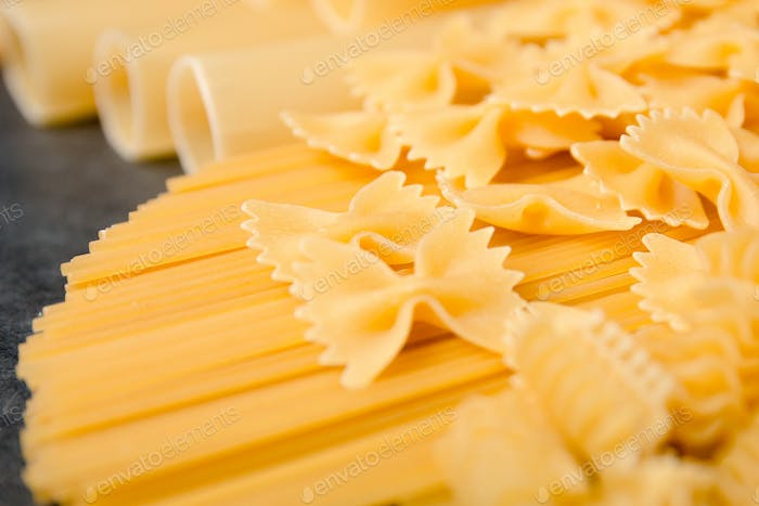 Mixed dried pasta selection on black wooden