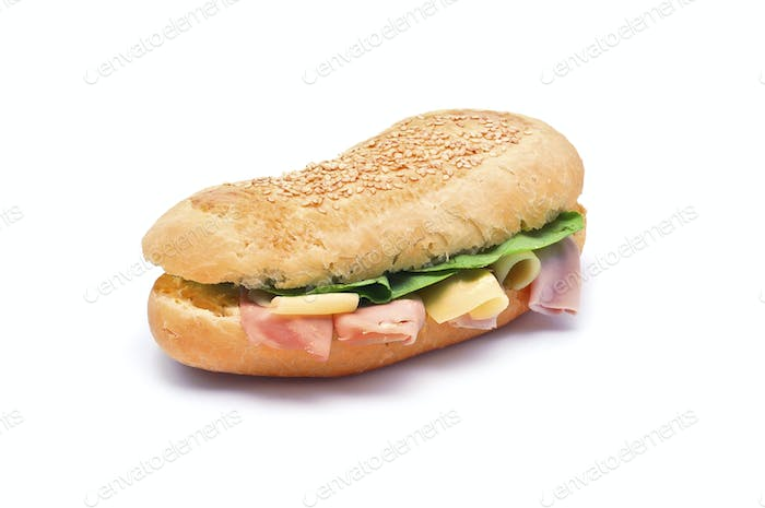 French sandwich. Long baguette with ham, cheese and green salad isolated on white background