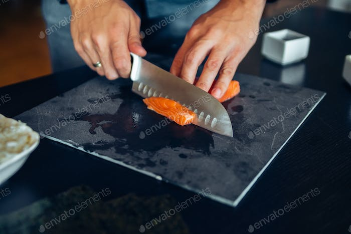 Cutting Salmon On The Board