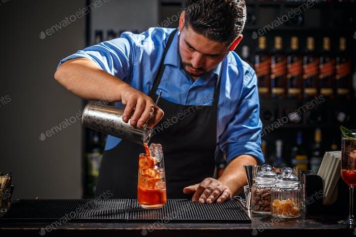 Bartender makes a cocktail