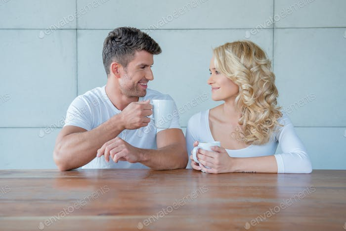 Happy couple chatting over morning coffee