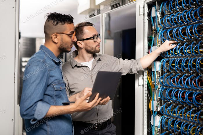 Computer support specialists analyzing network problem