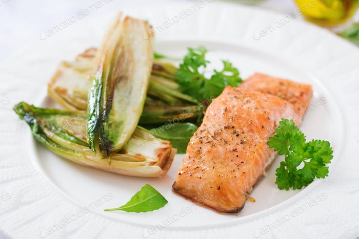 Baked salmon with Italian herbs and garnished with chicory