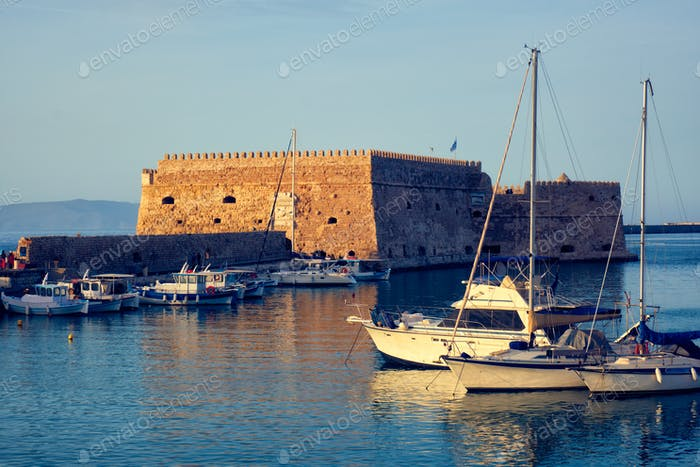 Venetian Fort in Heraklion and moored fishing boats, Crete Island, Greece