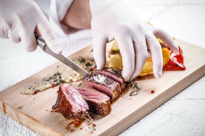 Chef cutting beef steak