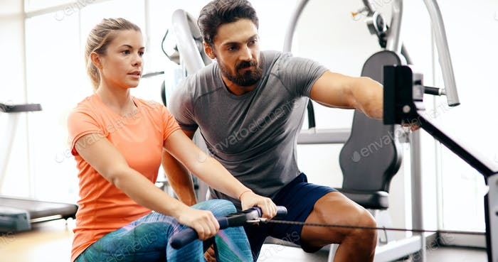 Personal trainer giving instructions in gym