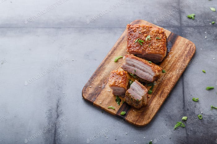 Thai crispy skin pork belly on wooden board, copy space