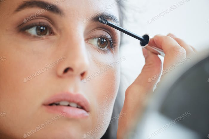 Woman Applying Eyebrow Gel