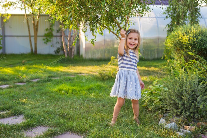 Portrait of sweet little girl play outdoors