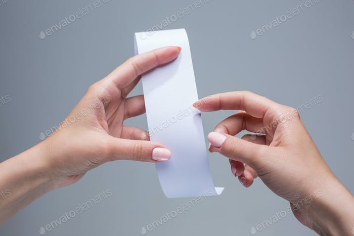 The female hands with  empty transaction paper or paper check