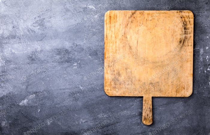Chopping board on the Gray Concrete Background.