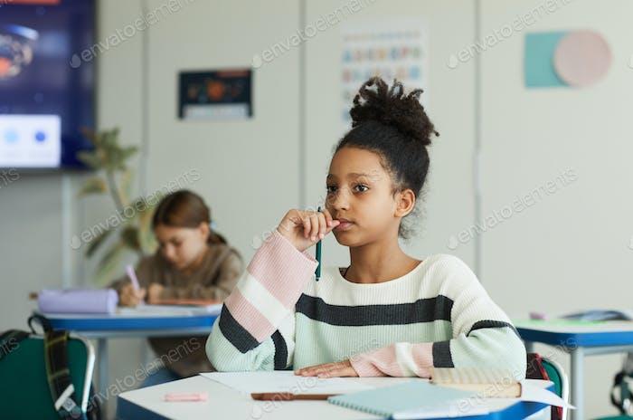 Teenage Girl Studying in School