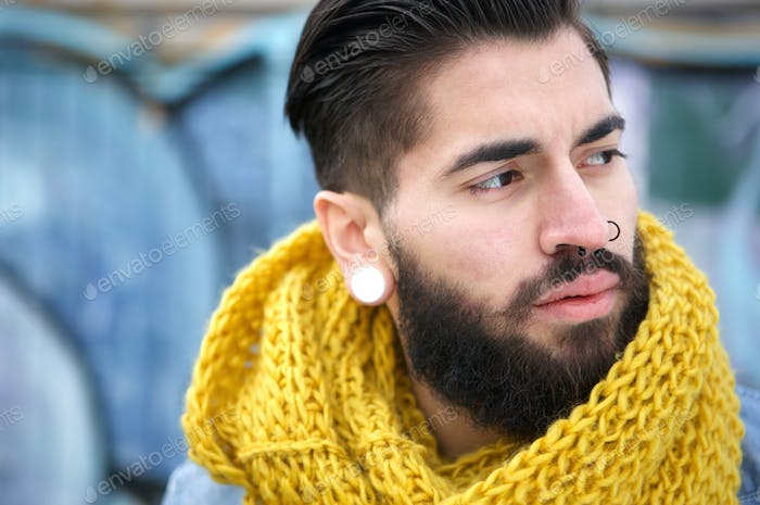 Portrait man with beard and scarf outdoors