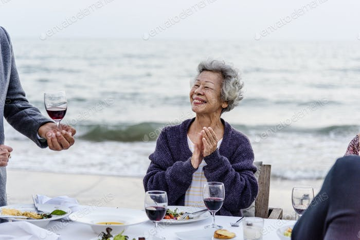 Seniors having a dinner party at the beach