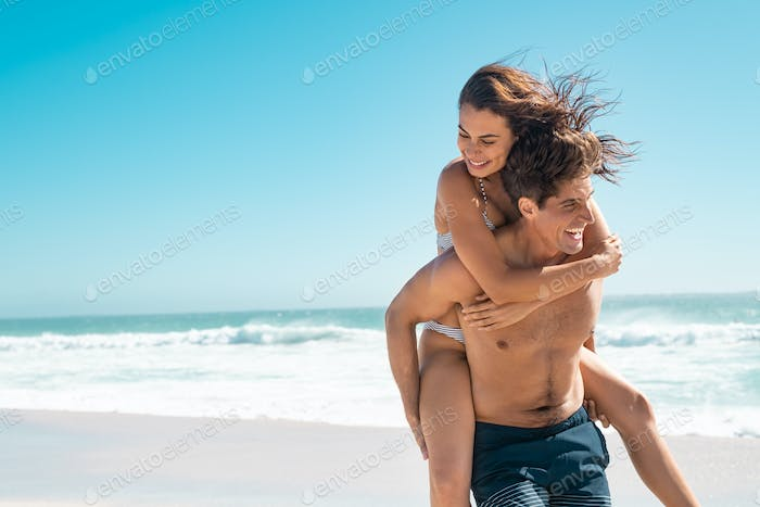 Loving couple enjoy summer at beach