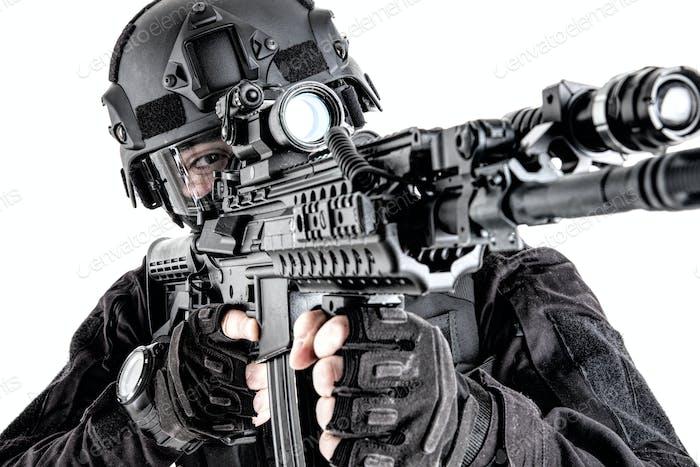 SWAT team member aiming weapon studio shoot
