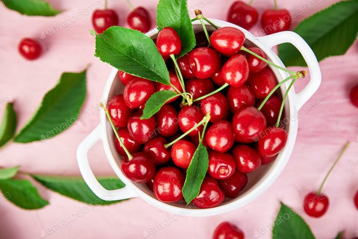 Ripe cherry berries and cherry leaf colourful bright pattern