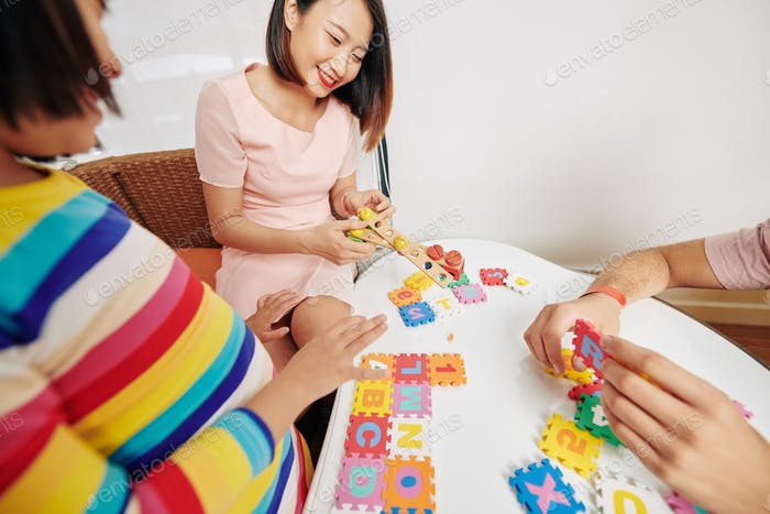 Parents showing puzzle to daughter