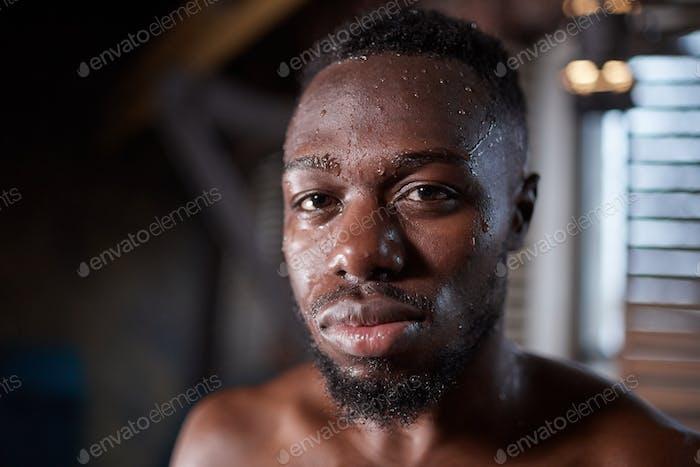 African shirtless man in gym