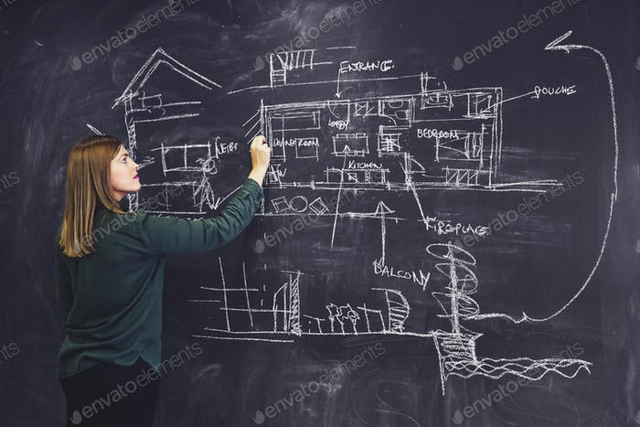Architect woman sketching new project on chalkboard.
