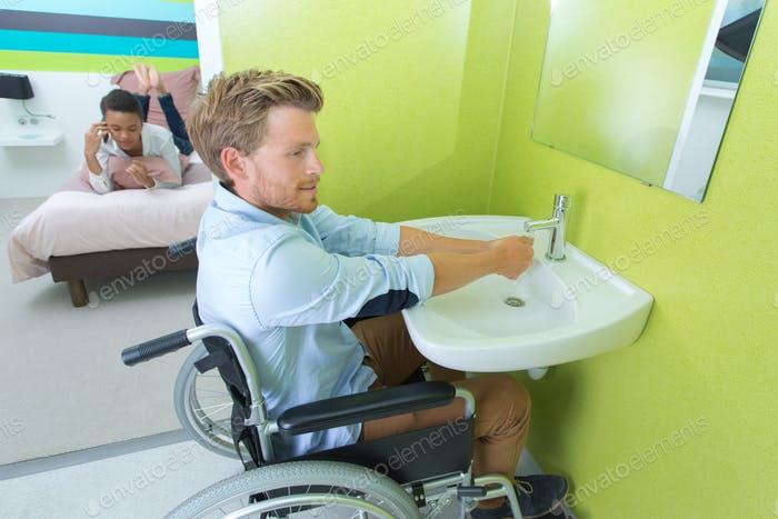 Handicapped man using hotel facilities