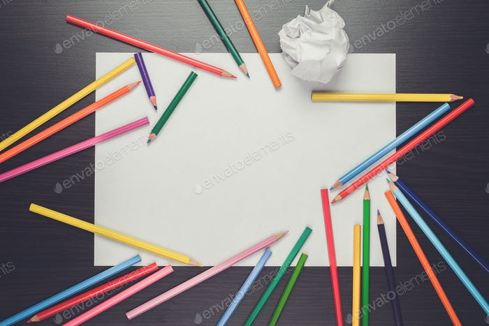 blank sheet of paper and colorful pencils creative process